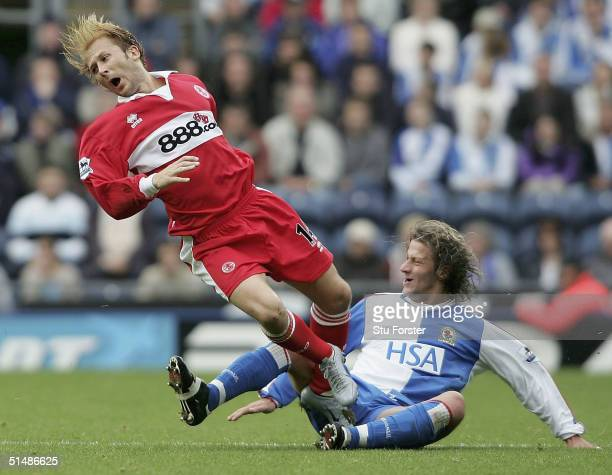 Blackburn player Tugay goes in on Gaizka Mendieta of Boro for his second yellow card and is sent off during the FA Barclays Premiership match between...