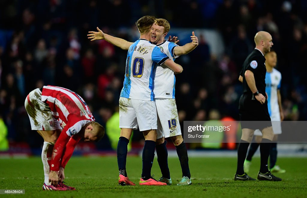 Blackburn players Tom Cairney (l) and Chris Taylor celebrate after the FA Cup Fifth round match between Blackburn Rovers and Stoke City at Ewood park on February 14, 2015 in Blackburn, England.