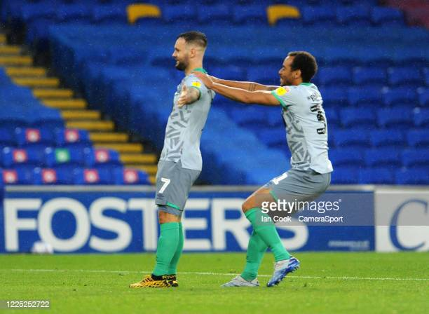 Blackburn Rovers' Adam Armstrong celebrates scoring his side's third goal with teammate Elliott Bennett during the Sky Bet Championship match between...