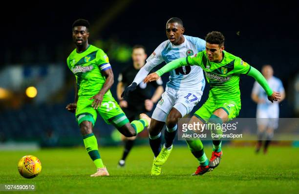 Blackburn Rovers' Amari'i Bell battles with Norwich City's Max Aarons and Alexander Tettey during the Sky Bet Championship match between Blackburn...