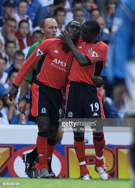 Blackburn Rover's Andy Cole celebrates with Dwight Yorke after his goal against Manchester city but was injured whilst scoring was taken off during...