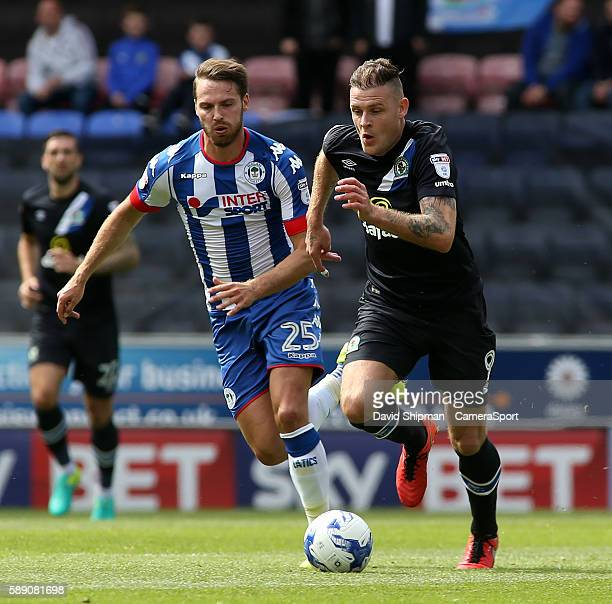 Blackburn Rovers' Anthony Stokes gets away from Wigan Athletic's Nick Powell during the EFL Sky Bet Championship match between Wigan Athletic and...