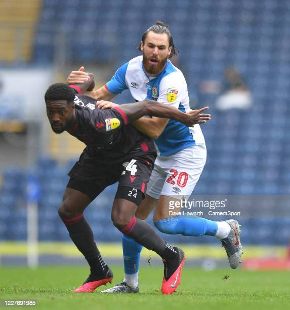 Blackburn Rovers' Ben Brereton battles with Reading's Tyler Blackett during the Sky Bet Championship match between Blackburn Rovers and Reading at...
