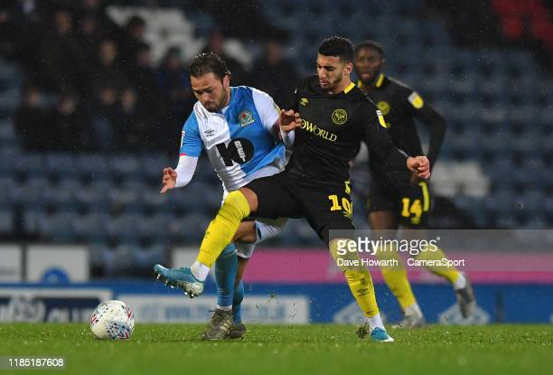 Blackburn Rovers' Bradley Dack battles with Brentford's Said Benrahma during the Sky Bet Championship match between Blackburn Rovers and Brentford at...