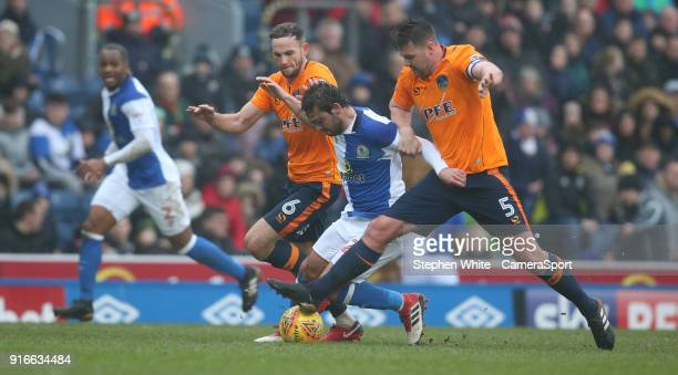 Blackburn Rovers' Bradley Dack battles with Oldham Athletic's Dan Gardner and Anthony Gerrard during the Sky Bet Championship match between Bolton...
