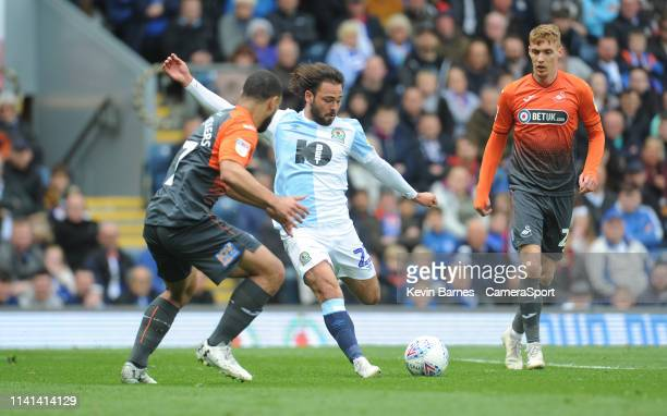 Blackburn Rovers' Bradley Dack under pressure from Swansea City's Cameron CarterVickers during the Sky Bet Championship match between Blackburn...