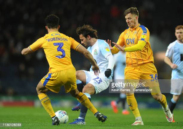 Blackburn Rovers' Bradley Dack under pressure from Wigan Athletic's Lee Evans and Antonee Robinson during the Sky Bet Championship match between...