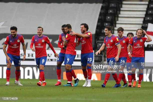 Blackburn Rovers' Bradley Johnson celebrates scoring the second goal against Derby County with his team mates during the Sky Bet Championship match...
