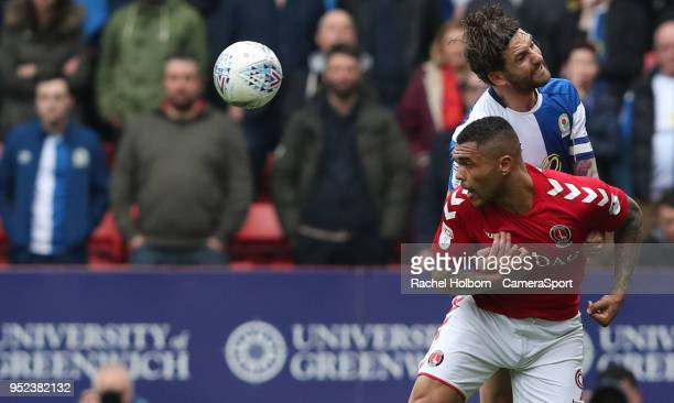 Blackburn Rovers' Charlie Mulgrew and Charlton Athletic's Josh Magennis during the Sky Bet League One match between Charlton Athletic and Blackburn...
