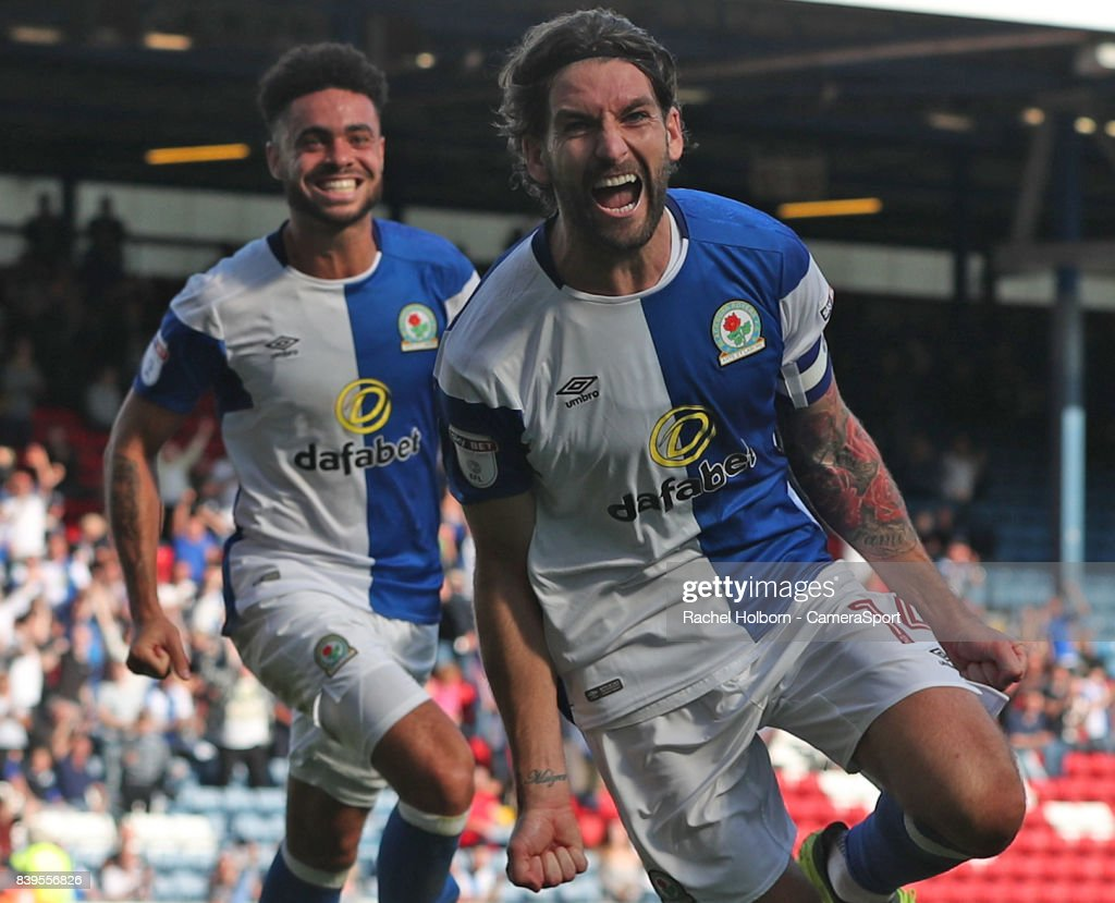 Blackburn Rovers' Charlie Mulgrew celebrates scoring his side's third goal during the Sky Bet League One match between Blackburn Rovers and Milton Keynes Dons at Ewood Park on August 26, 2017 in Blackburn, England.