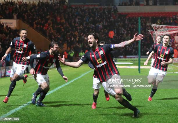 Blackburn Rovers' Charlie Mulgrew celebrates scoring the goal that sees his side promoted during the Sky Bet League One match between Doncaster...