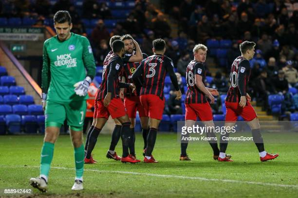 Blackburn Rovers' Charlie Mulgrew celebrates with his team mates after scoring their first goal during the Sky Bet League One match between...