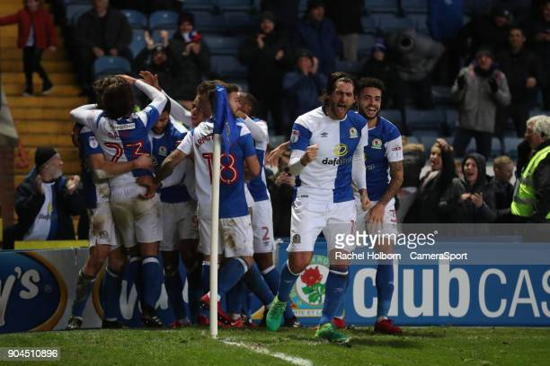 Blackburn Rovers' Charlie Mulgrew is swamped by teammates after scoring the third goal with Blackburn Rovers' Danny Graham leading the...