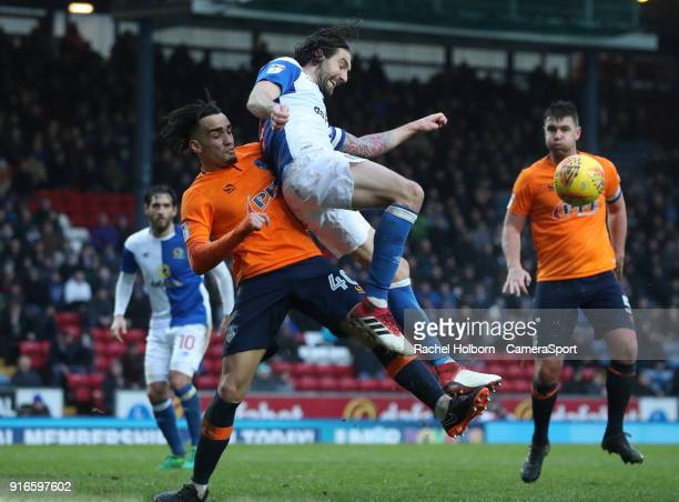 Blackburn Rovers' Charlie Mulgrew is tackled by Oldham Athletic's Kean Bryan during the Sky Bet League One match between Blackburn Rovers and Oldham...