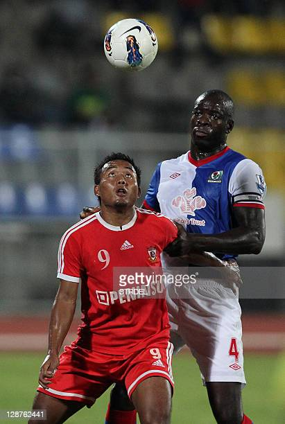 Blackburn Rovers Congolese defender Christopher Samba battles for the ball with a Pune forward during the game between Blackburn Rovers and Pune FC...