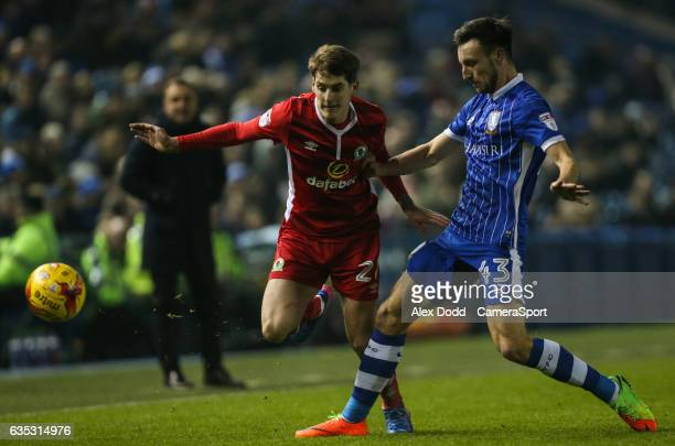 Blackburn Rovers' Connor Mahoney is tackled by Sheffield Wednesday's Morgan Fox during the Sky Bet Championship match between Sheffield Wednesday and...