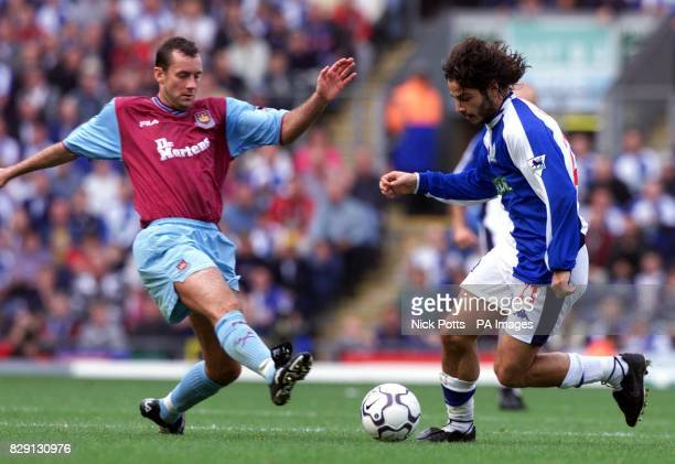 Blackburn Rovers' Corrado Grabbi races past the tackle of West Ham's Don Hutchinson during the FA Barclaycard Premiership game at Ewood Park...