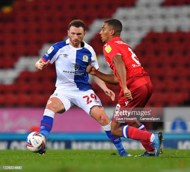 Blackburn Rovers' Corry Evans battles with Reading's Andy Rinomhota during the Sky Bet Championship match between Blackburn Rovers and Reading at...