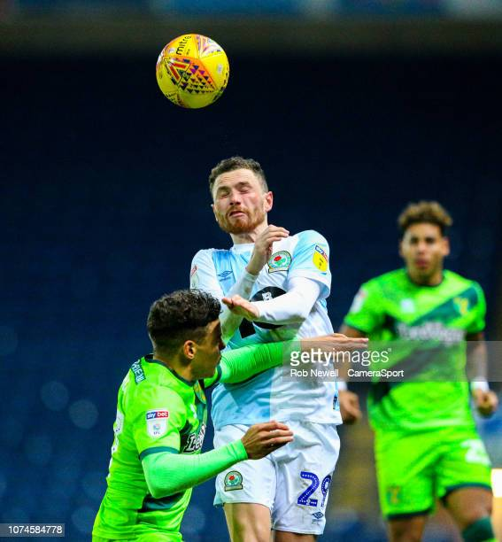 Blackburn Rovers' Corry Evans wins a header over Norwich City's Max Aarons during the Sky Bet Championship match between Brentford and Bolton...