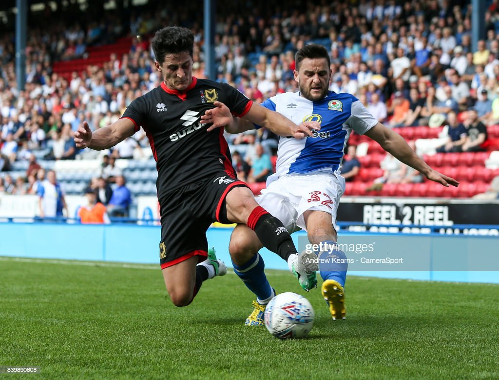 Blackburn Rovers' Craig Conway competing with Milton Keynes Dons' George Williams during the Sky Bet League One match between Blackburn Rovers and Milton Keynes Dons at Ewood Park on August 26, 2017 in Blackburn, England.