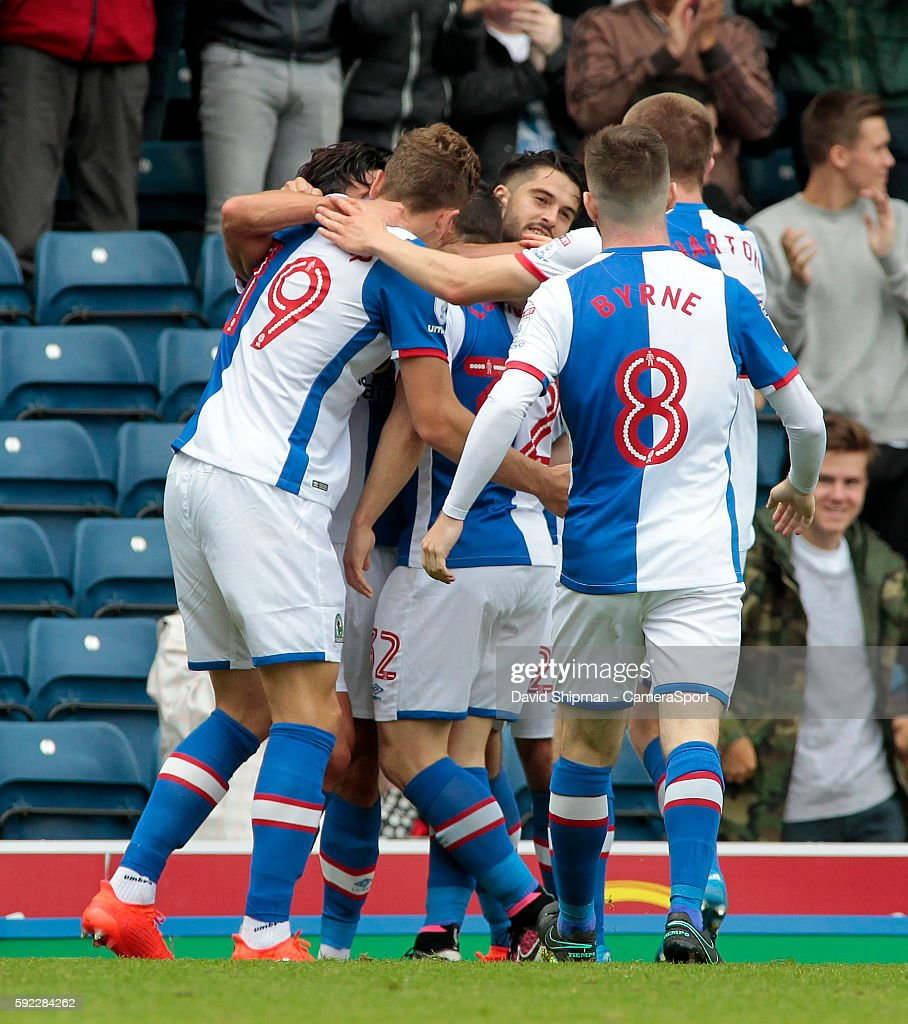 Blackburn Rovers' Craig Conway is mobbed after scoring his sides first goal during the Sky Bet Championship match between Blackburn Rovers and Burton Albion at Ewood park on August 20, 2016 in Blackburn, England.