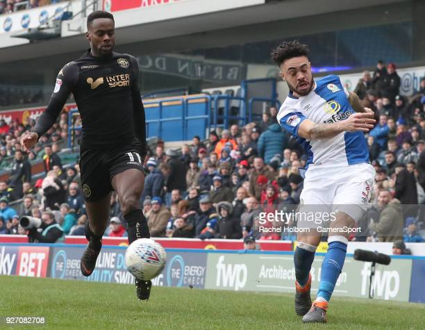 Blackburn Rovers' Derrick Williams and Wigan Athletic's Gavin Massey during the Sky Bet League One match between Blackburn Rovers and Wigan Athletic...