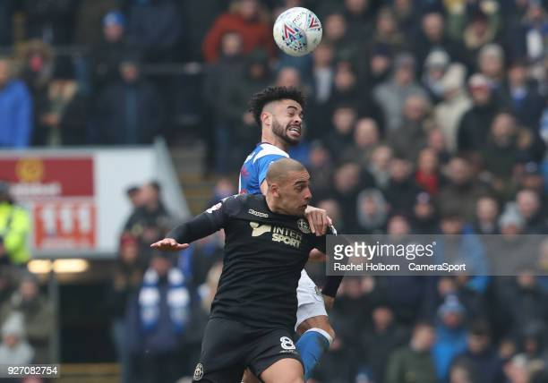Blackburn Rovers' Derrick Williams and Wigan Athletic's Lee Evans during the Sky Bet League One match between Blackburn Rovers and Wigan Athletic at...