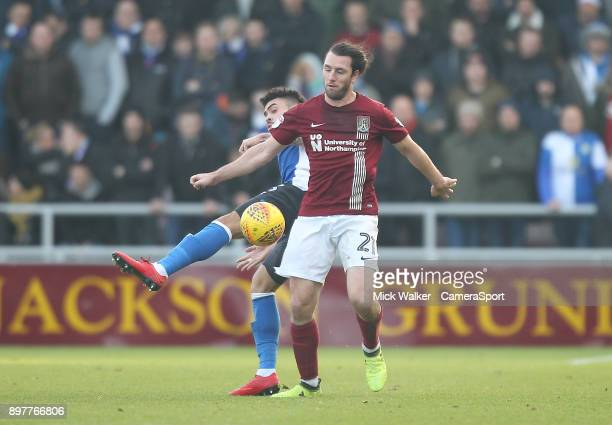 Blackburn Rovers Derrick Williams battles with Northampton Town's JohnJoe O'Toole during the Sky Bet League One match between Northampton Town and...