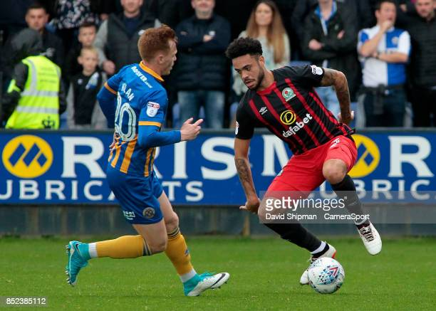 SHREWSBURY ENGLAND SEPTEMBER Blackburn Rovers' Derrick Williams takes on Shrewsbury Town's Jon Nolan during the Sky Bet League One match between...