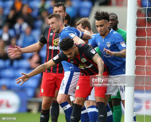 Blackburn Rovers' Derrick Williams watched by Oldham Athletic's Kean Bryan and Peter Clarke as they wait for a corner kick during the Sky Bet League...