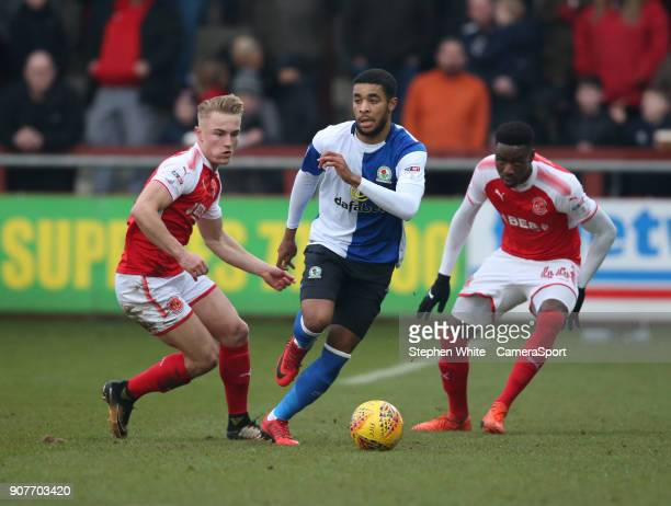 Blackburn Rovers' Dominic Samuel battles with Fleetwood Town's Kyle Dempsey and Devante Cole during the Sky Bet League One match between Fleetwood...