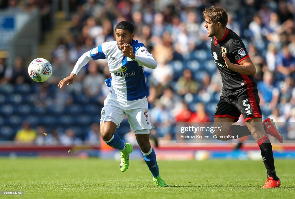 Blackburn Rovers' Dominic Samuel competing with Milton Keynes Dons' Scott Wootton for possession during the Sky Bet League One match between Blackburn Rovers and Milton Keynes Dons at Ewood Park on August 26, 2017 in Blackburn, England.