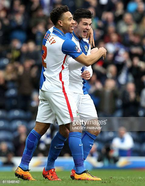 Blackburn Rovers' English midfielder Ben Marshall celebrates with Blackburn Rovers' Welsh defender Adam Henley after scoring the opening goal of the...