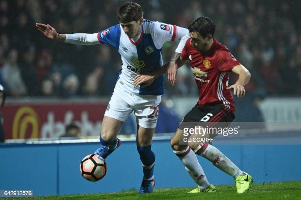 Blackburn Rovers' English midfielder Connor Mahoney vies with Manchester United's Italian defender Matteo Darmian during the English FA Cup fifth...