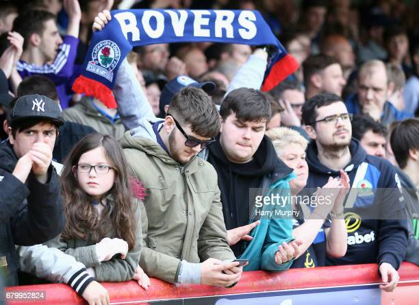 Blackburn Rovers fan checks his phone after the Sky Bet Championship match between Brentford and Blackburn Rovers at Griffin Park on May 7 2017 in...