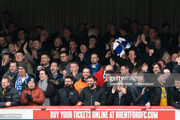 Blackburn Rovers fans celebrate their teams goal during the Sky Bet Championship match between Brentford and Blackburn Rovers at Griffin Park on...