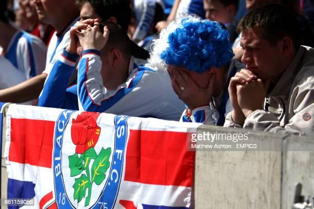 Blackburn Rovers' fans sit dejected after defeat against Arsenal