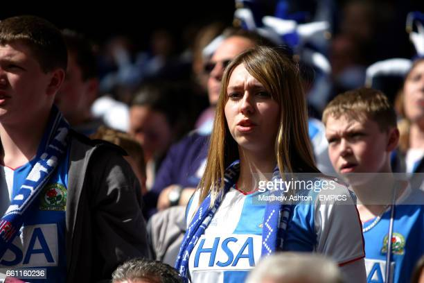 Blackburn Rovers' fans watch the action with a look of despair