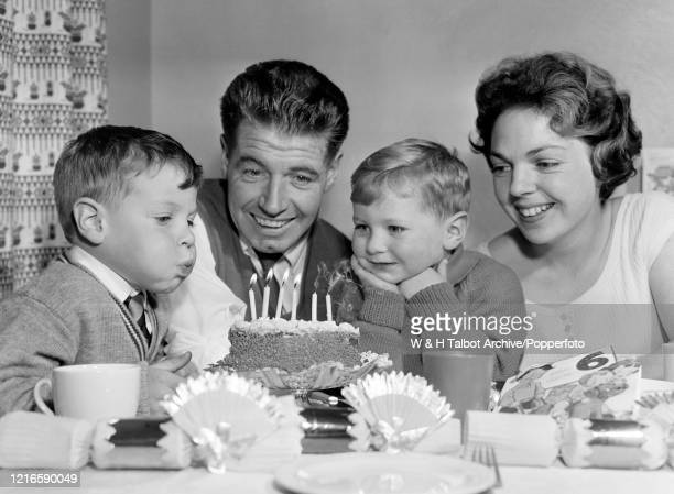 Blackburn Rovers footballer Fred Else with his wife and children celebrating a birthday at home in Blackburn, England, circa October 1962.