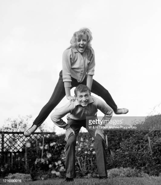 Blackburn Rovers footballer Ian Lawther and his fiance celebrating their engagement at home in Blackburn, England, circa October 1962.