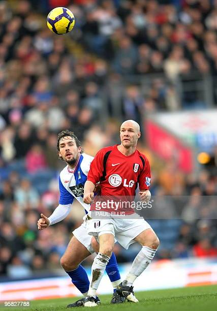Blackburn Rovers' French defender Gael Givet competes with Fulham's English forward Andrew Johnson during their English Premier League football match...