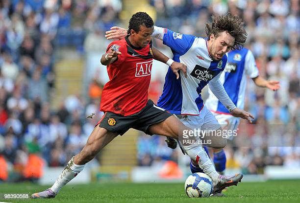 Blackburn Rovers' French defender Gael Givet vies with Manchester United's Portuguese midfielder Nani during the English Premier League football...
