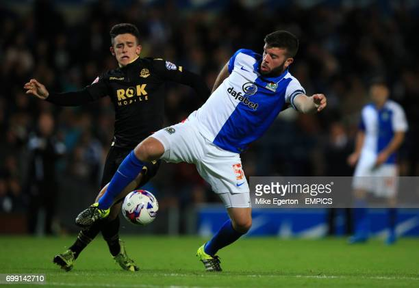 Blackburn Rovers' Grant Hanley and Bolton Wanderers' Zach Clough battle for the ball
