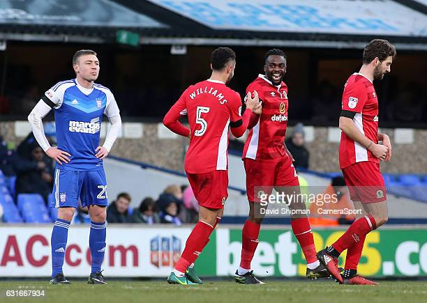Blackburn Rovers' Hope Akpan celebrates scoring his sides equalising goal to make the score 11 with Derrick Williams during the Sky Bet Championship...