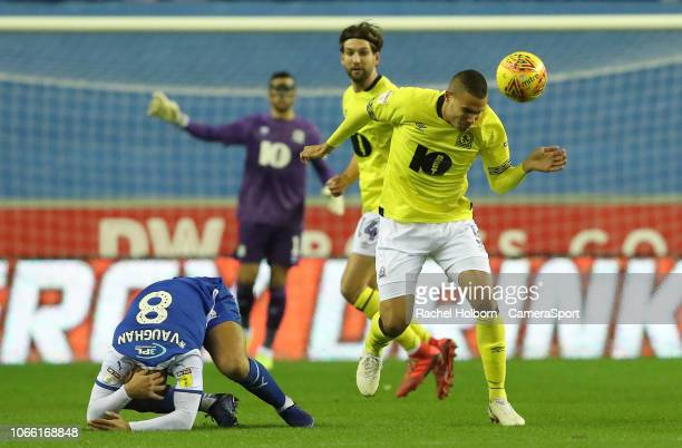 Blackburn Rovers' Jack Rodwell and Wigan Athletic's James Vaughan during the Sky Bet Championship match between Wigan Athletic and Blackburn Rovers...