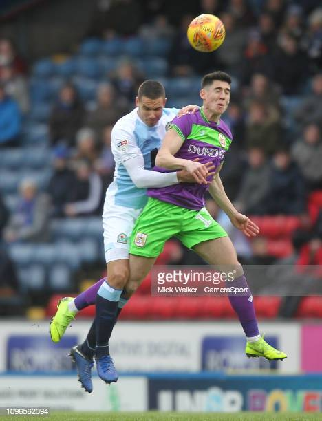 Blackburn Rovers Jack Rodwell jumps with Bristol City's Lloyd Kelly during the Sky Bet Championship match between Blackburn Rovers and Bristol City...