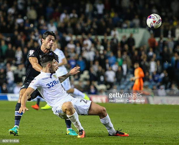 Blackburn Rovers' Jason Lowe battles with Leeds United's Alex Mowatt during the EFL Cup Third round match between Leeds United and Blackburn Rovers...