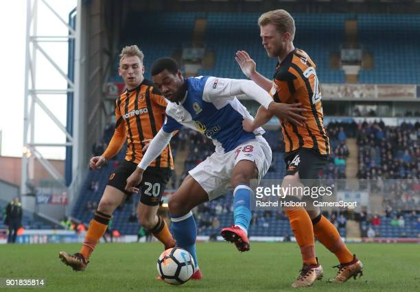 Blackburn Rovers' Joe Nuttall under pressure from Hull City's Max Clark and Hull City's Jarrod Bowen during the Emirates FA Cup Third Round match...