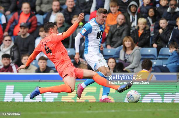 Blackburn Rovers' Joe Rothwell is tackled by Huddersfield Town's Tommy Elphick during the Sky Bet Championship match between Blackburn Rovers and...