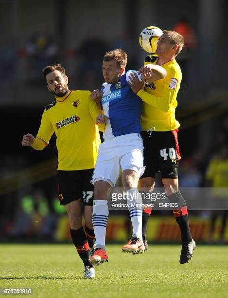Blackburn Rovers' Jordan Rhodes battles for the ball with Watford's Joel Ekstrand and Marco Cassetti